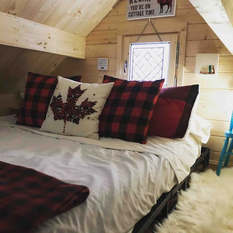 Our cozy loft bedroom is equipped with luxurious bedding and everything you need to watch a movie or read a book. A second solar generator and sound machine is yours to use to either plug in the second electric blanket or power your devices.