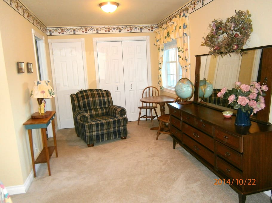 The Garden Room is large with a small table and chairs.