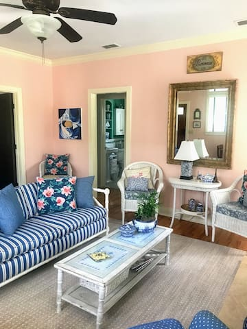The cozy sitting room has ample seating.