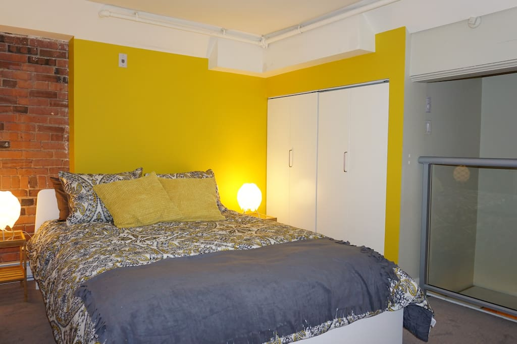 Beautiful bright bedroom with queen sized bed