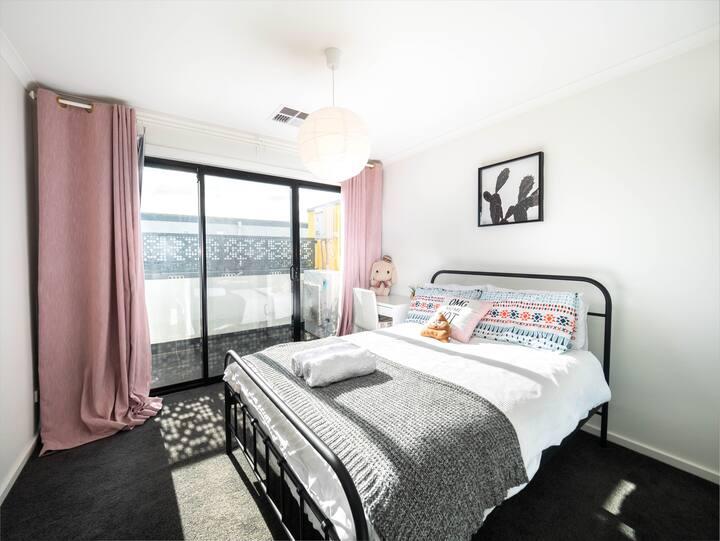 Bedroom with balcony near city, train & shops