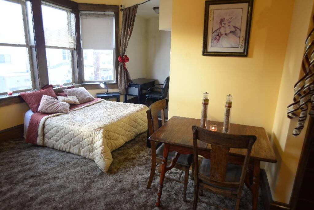Desk, Queen Bed, Oak dining table.