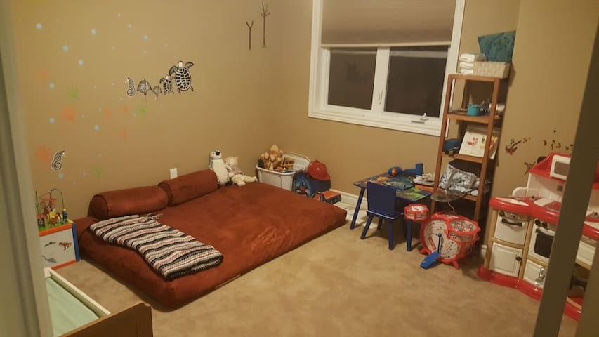kids room with one futon mattress, one toddler bed (or crib) and toys. Closet space available.