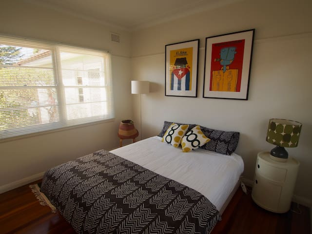 A sunny bedroom with a new (firm) queen bed