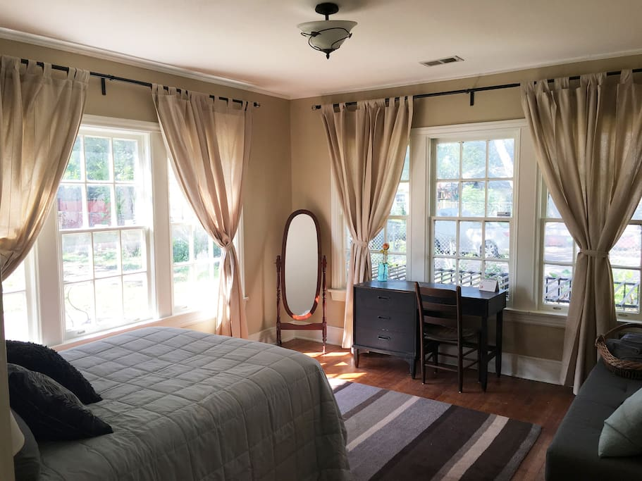 The Private Cottage Room named Gladwell - a comfortable full bed, desk, twin futon, full length mirror, and humongous windows for natural light!