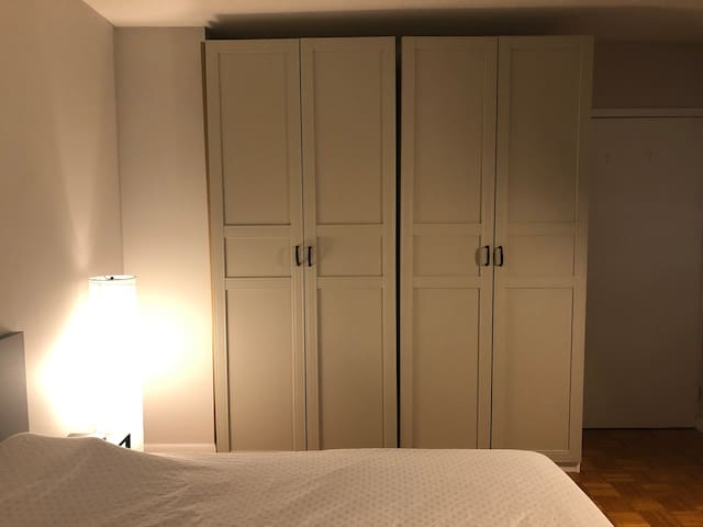 Simple layout with Queen sized bed, drawers and hanging space in wardrobe, and desk.