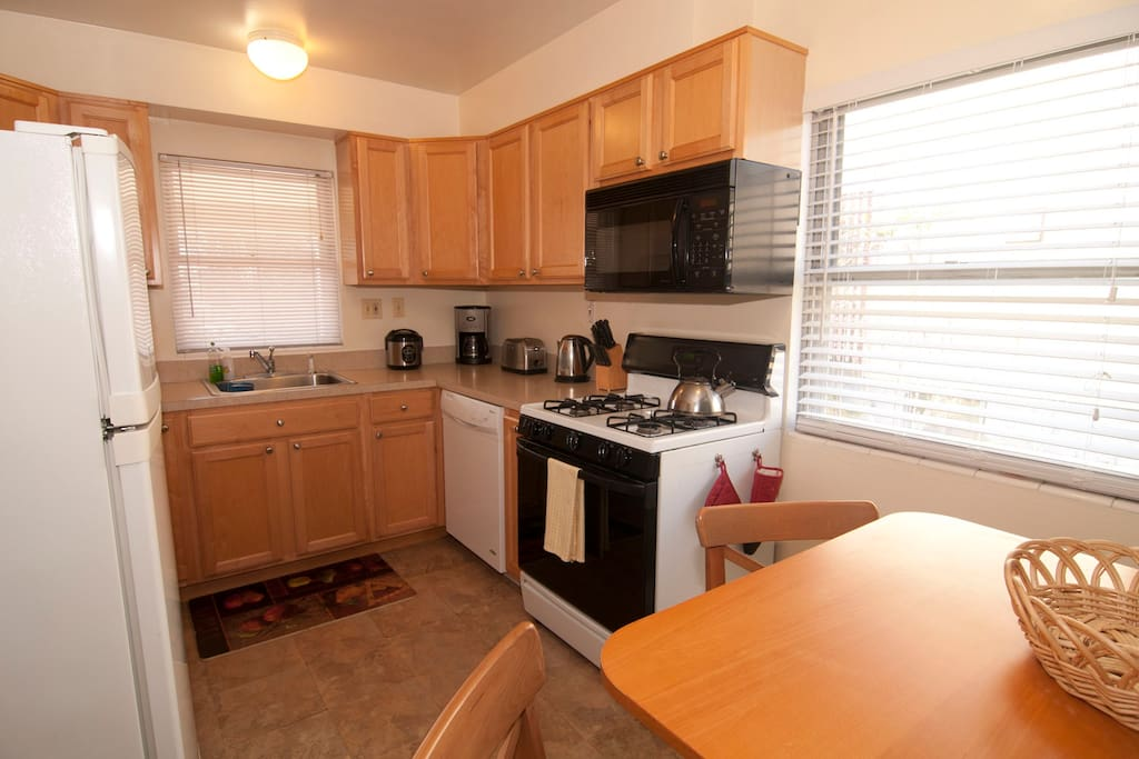Fully equipped kitchen includes toaster, rice cooker, electric kettle, coffee maker and more.