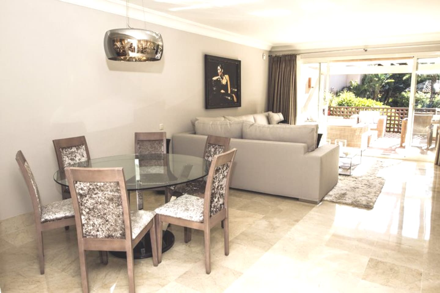 Boutique living & dining area with large wall mounted TV and Blue Ray DVD player. Access into main terrace.