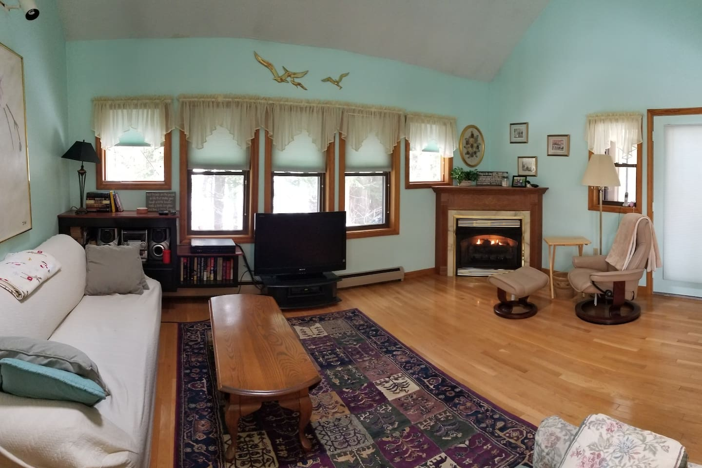 Living room & fireplace. Extra long couch and pull out twin size love seat sofabed.  Cable TV with DVD player.