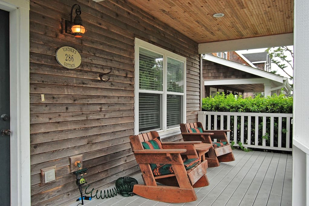 Front porch with comfortable Adirondack chairs.