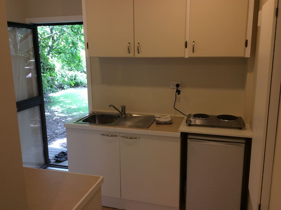 Kitchenette;sink, hob & fridge.