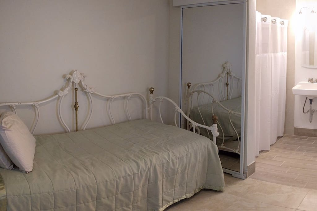 The bedroom area is separated from the bathroom by sliding doors.