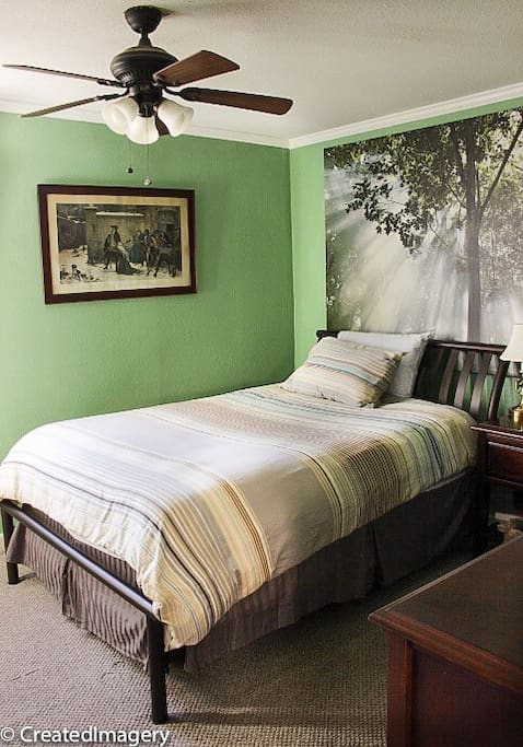 Master bedroom, queen bed with a sunny window