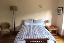 Double bed with new mattress. Additional child's mattress can be supplied on request.