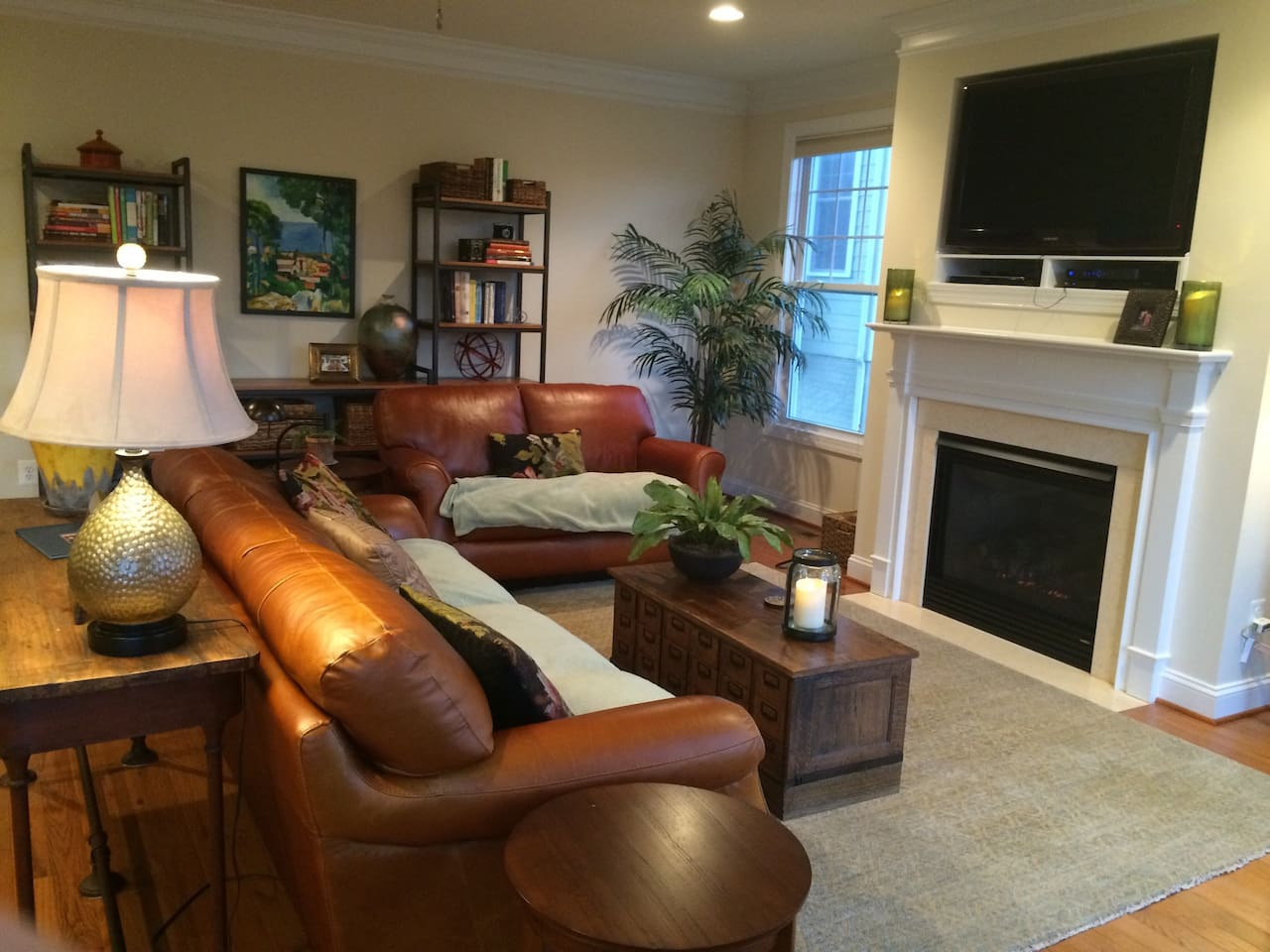 Comfortable living room with 46 inch television and gas fireplace