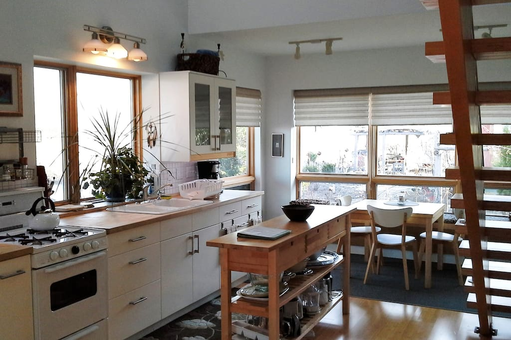 Kitchen /dining nook is  fully equipped and sun filled