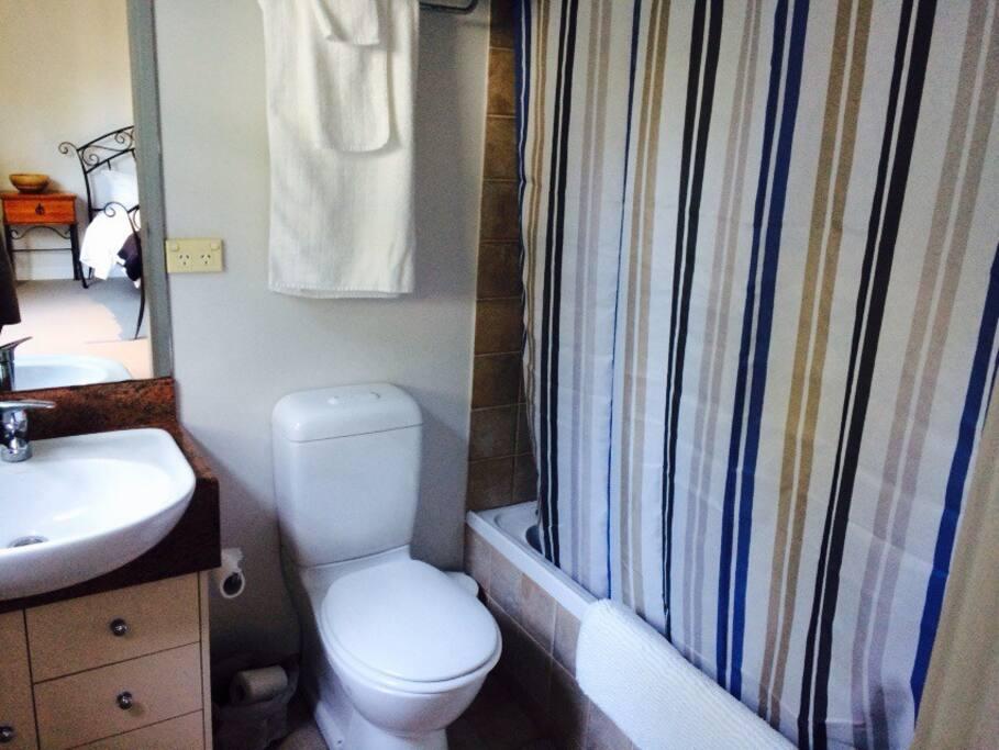 Full bathroom with full sized bath