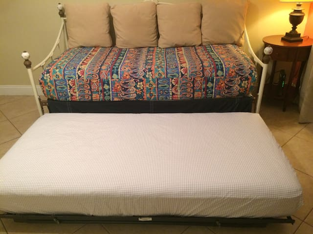 Day bed with trundle bed underneath. Both matresses are TWIN.