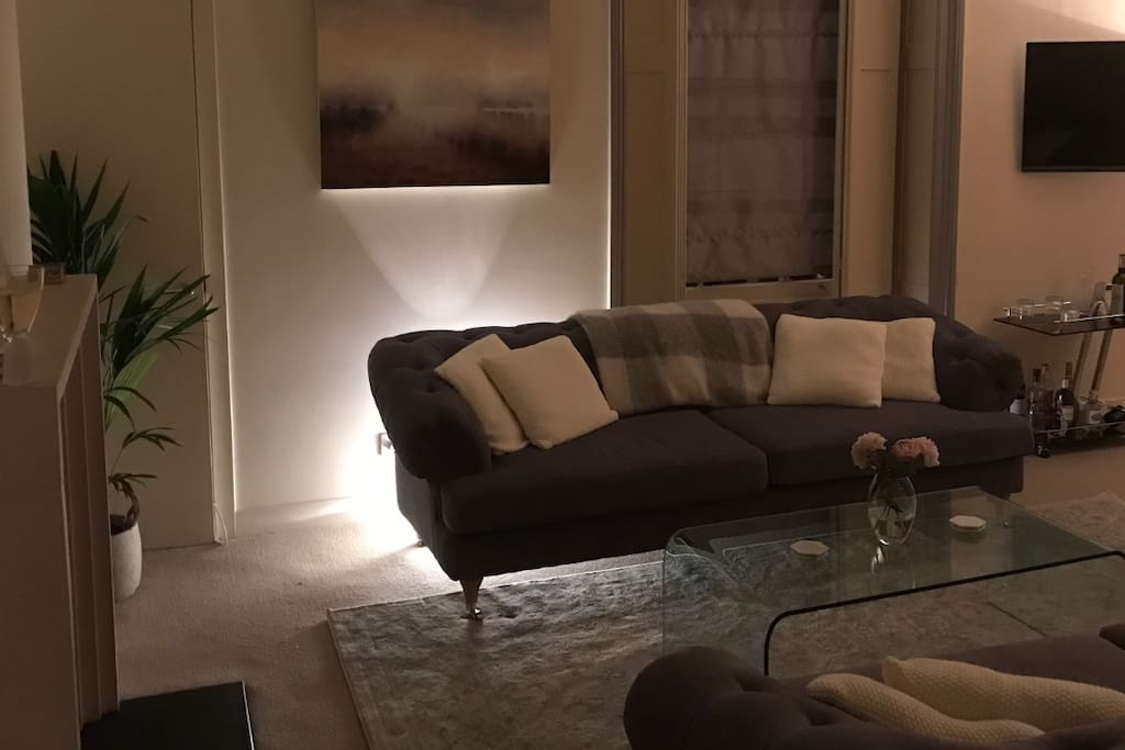 Luxurious living room with large sofas and original artworks