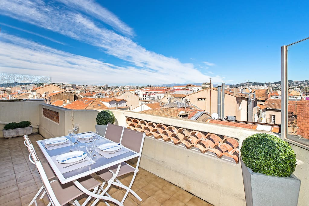 Panoramic view on Cannes hills from the living room terrasse (there is an umbrella also)