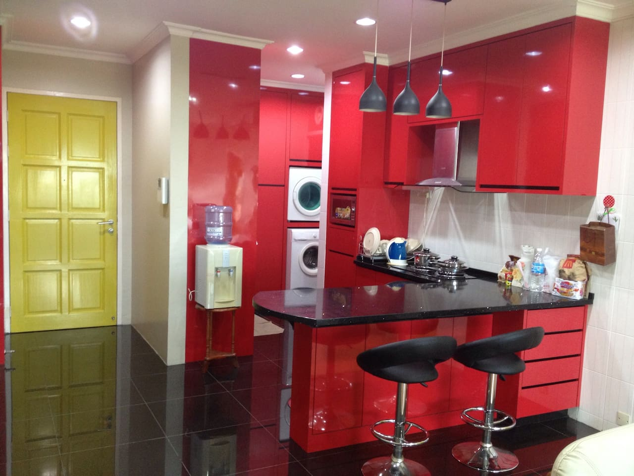 Modern kitchen with electrical cooking stove, comprehensive cooking tools are provided too. Equipped with microwave, frige, washing machine and dryer.