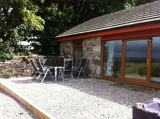 An idyllic luxury byre a step away from the beach