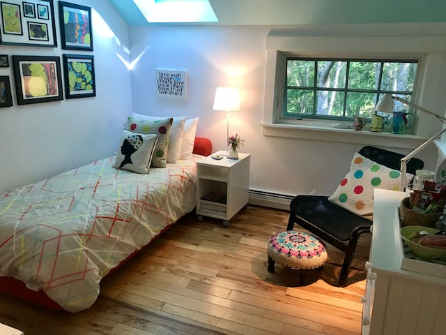 Your room includes a sky light window from your bed and a reading chair and light nestled into a corner window with a woodsy view.