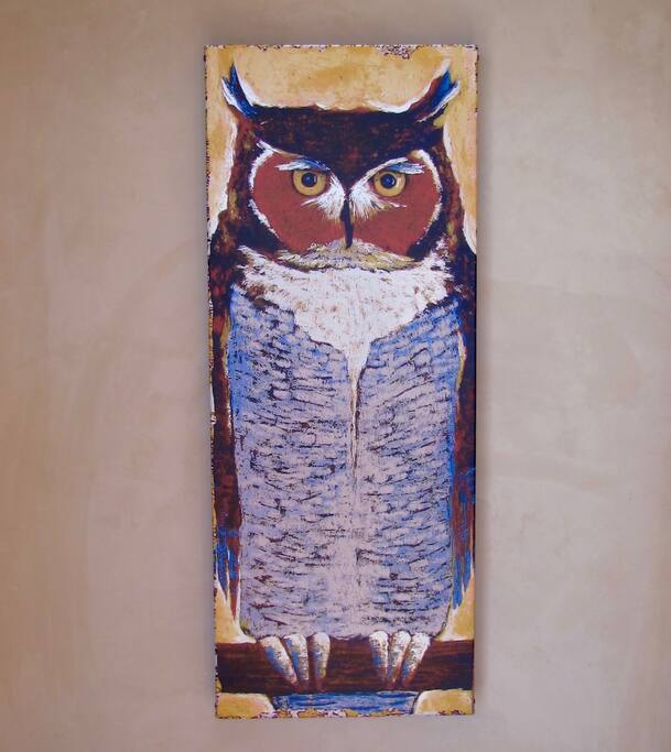 The metal art owl that gives the home its name welcomes you.
