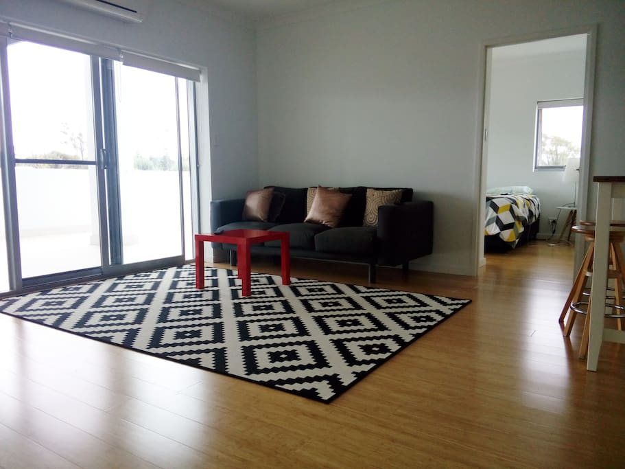 Ample living area with access to 90m2 balcony