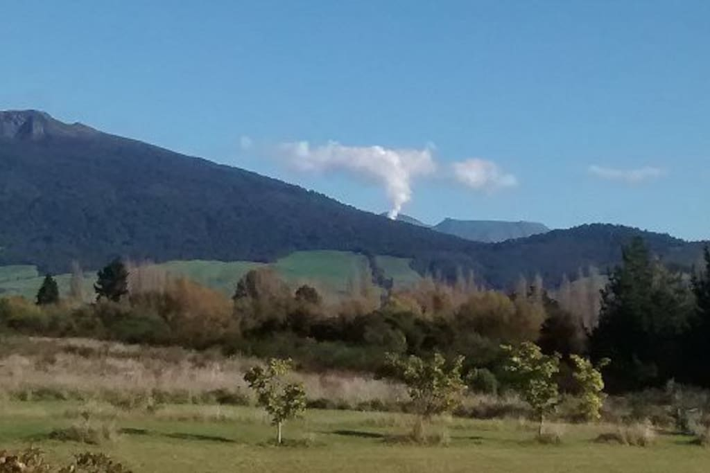 The view from your bedroom with a smoking volcano to thrill you.