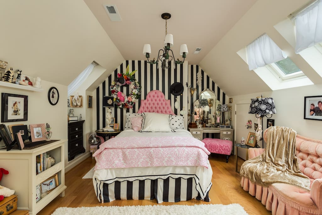 Upstairs full/double bedroom with fun personal touches and design