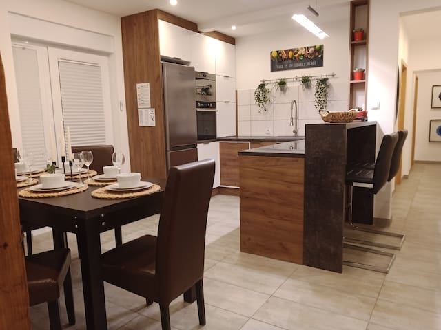 Three-bed ground floor apartment with terrace