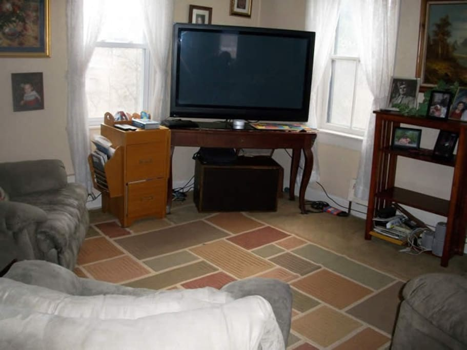 This lovely old farmhouse has a spacious living room with comfortable seating and satellite TV.