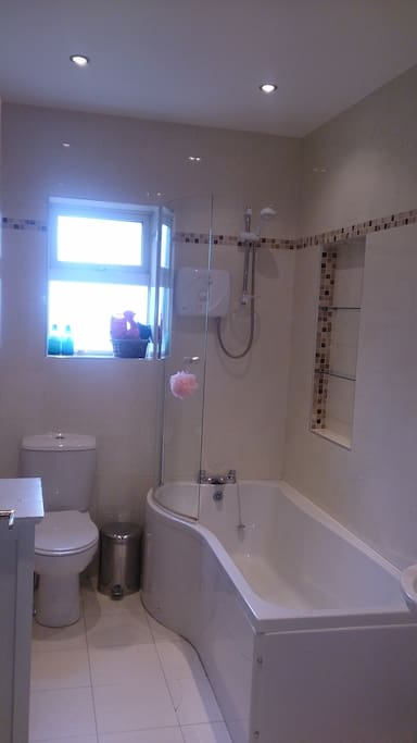 Family bathroom with electric shower