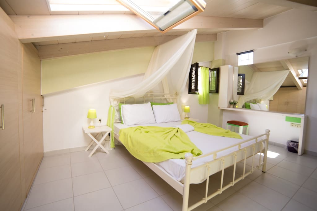 The bedroom on the loft of the apartment