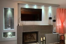 50 inch TV and Gas burning fireplace