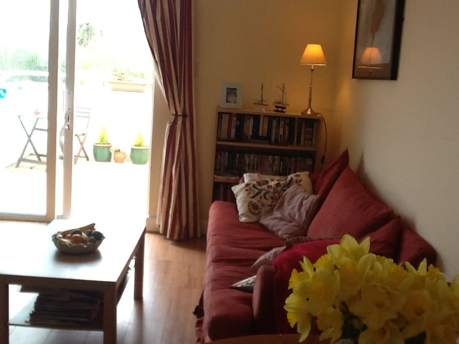 Living area with t.v., DVD player and  access to sunny balcony