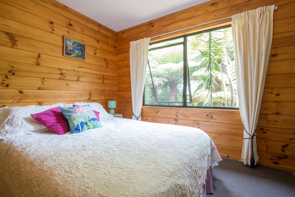 This is a very peaceful light room with lovely bush outlook