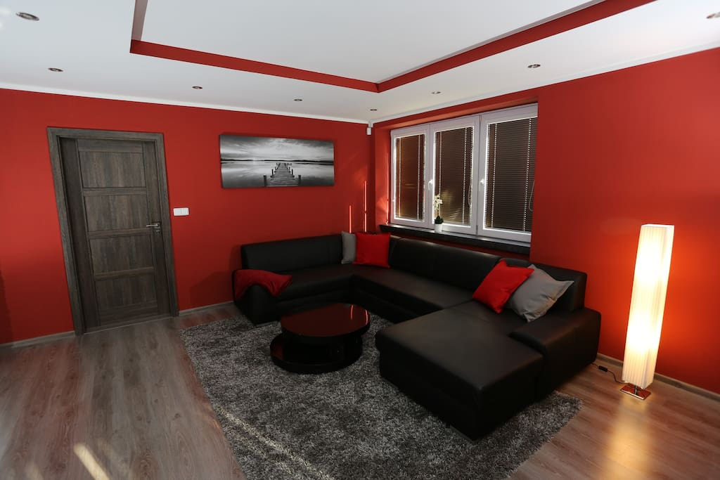 living room with sofa bed for two, big screen TV, fireplace