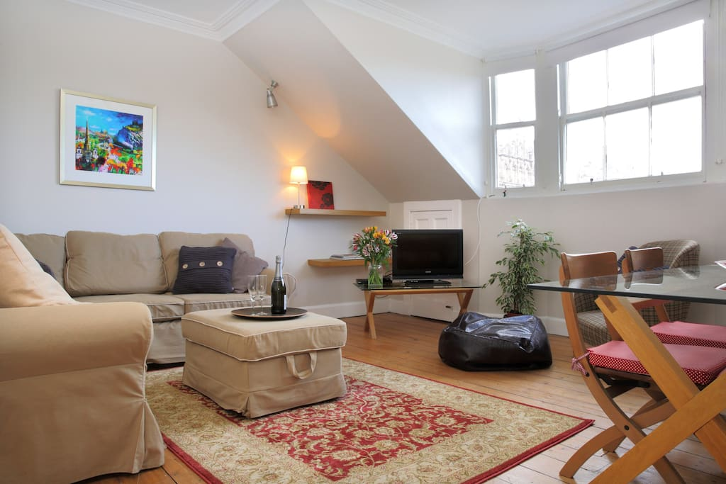 The living room has a big corner sofa that can pull out into a double bed. The window overlooks the west end of princes street gardens. There is a comfy armchair and a dining area for 4 people.