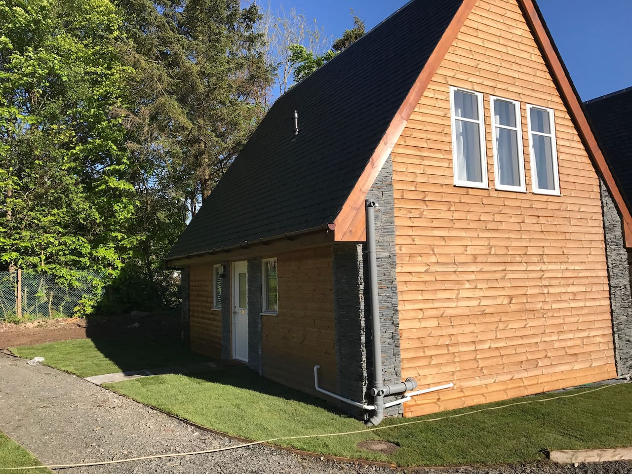 Side view of the chalet. Brand new lodge located right on the banks of Loch Lomond!
