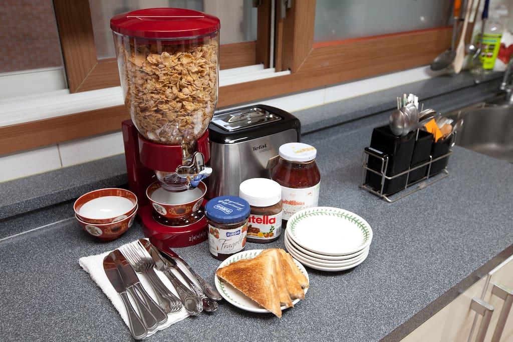We serve breakfast(breads,cereals,fresh milk,teas etc) for free.