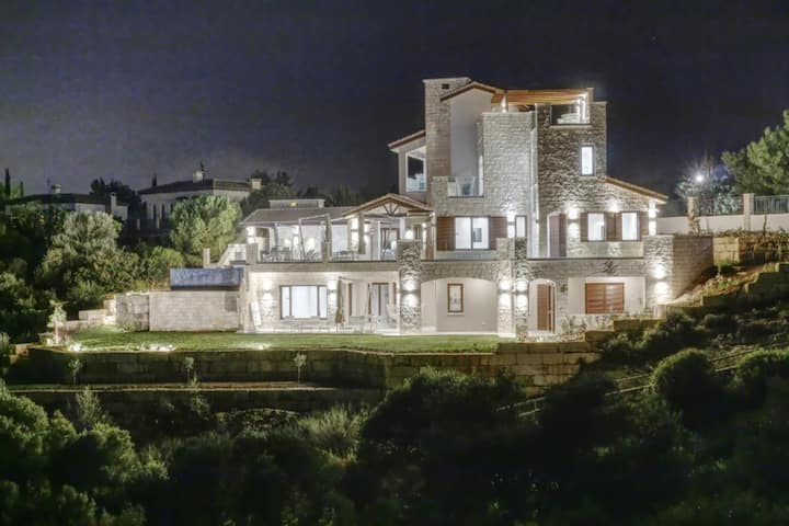 Five star luxury villa nestling atop two plateaux overlooking the glistening Mediterranean sea