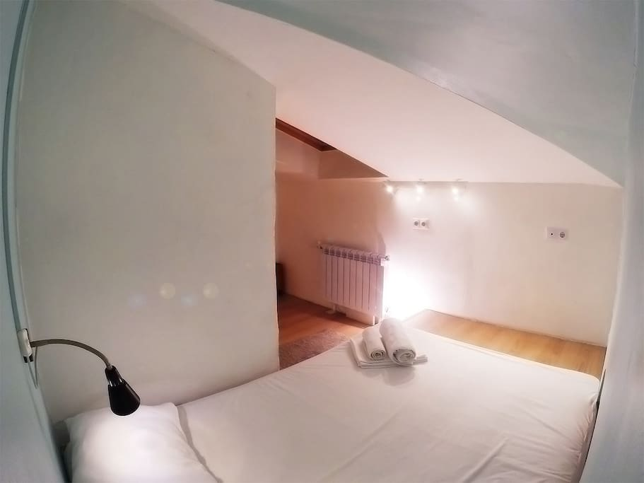 Cozy double bed in mint room