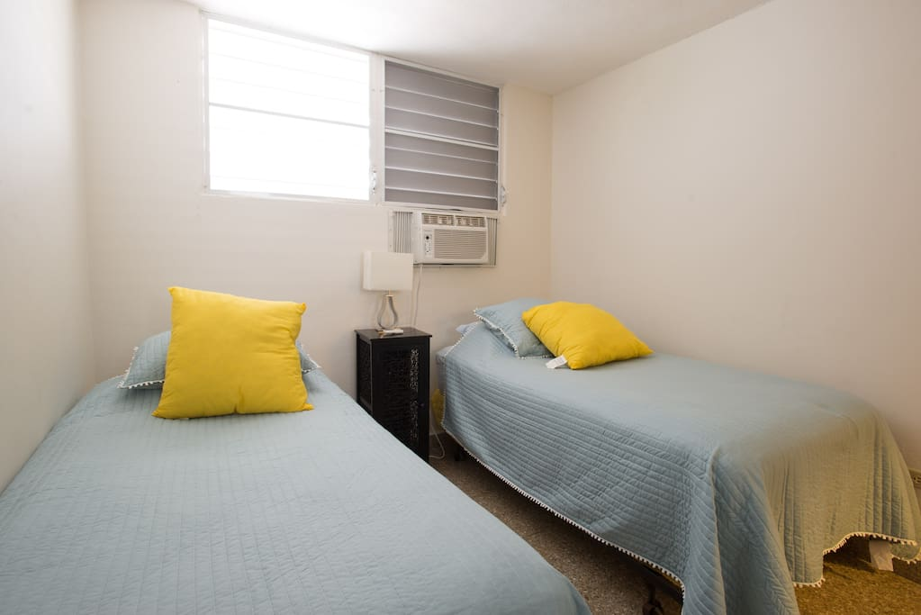 Third bedroom with twin beds that can be rolled together.