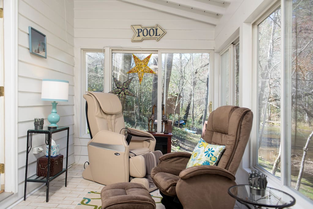 Sunroom - full of windows overlooking the river and the awesome massage chair in the corner.