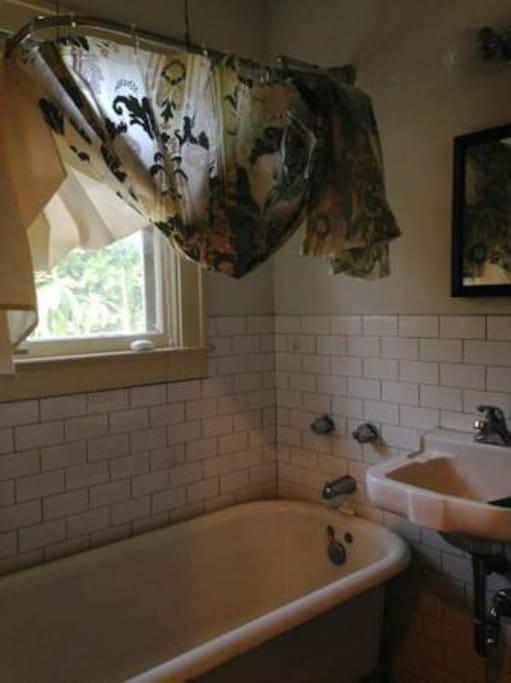 Claw foot bathtub in shared bathroom.
