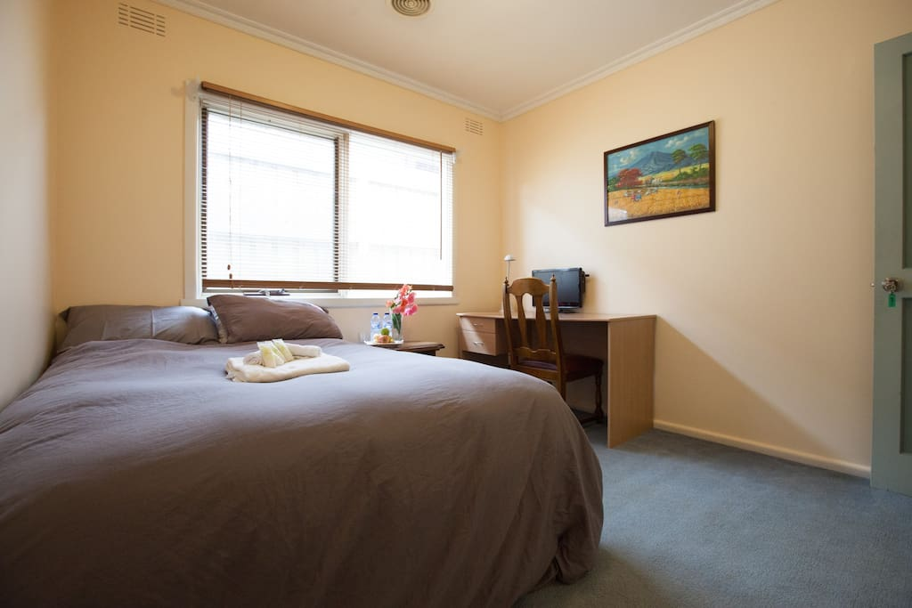 Double Bed with Doona Cover, Pillows, Bath Towel, Hand Towel, Desk, Chair and window.