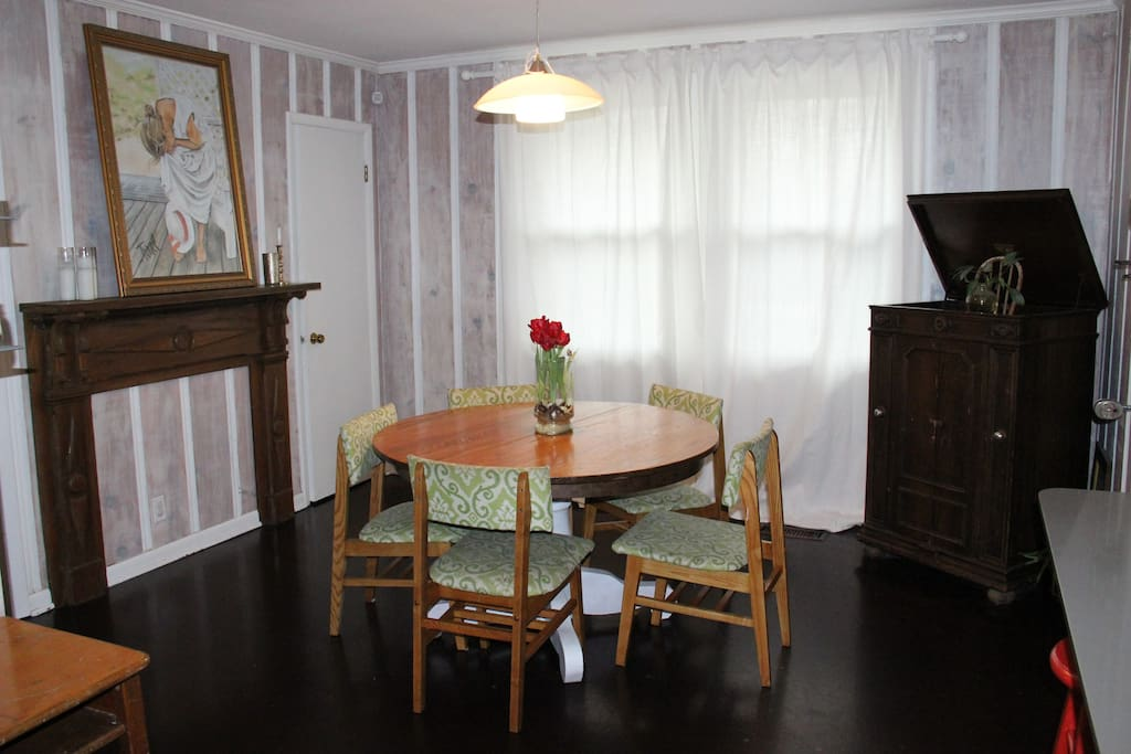 The dining room is open to the kitchen and den. Table leaf/extender and extra matching chairs available.