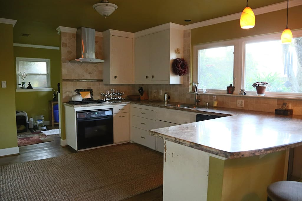 Gas stovetop with electric oven. Granite counters, hardwoods throughout.